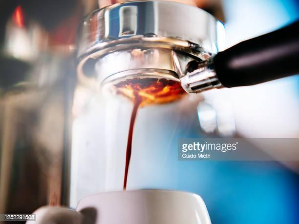coffee machine pouring out espresso. - guido mieth stock pictures, royalty-free photos & images