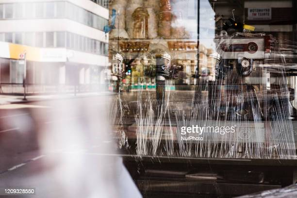 Coffee machine stands wrapped in cling film in a closed branch of coffee chain Costa Coffee on Portman Street in London, England, on April 6, 2020....