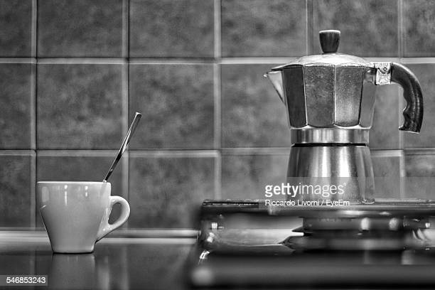 Coffee Maker And Cup In Kitchen