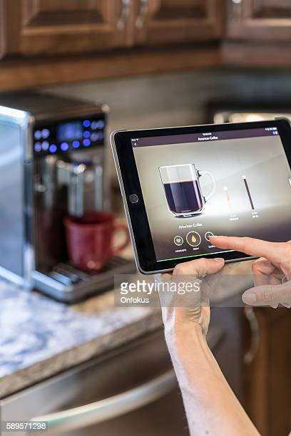 Coffee Maker inside Smart Homes Being Controlled on Digital Tablet