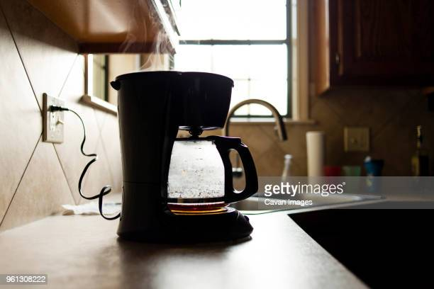 coffee maker on kitchen counter - coffee maker stock pictures, royalty-free photos & images