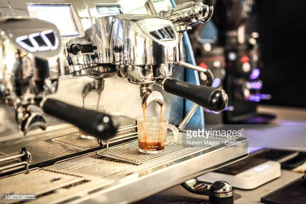 coffee maker pouring drink in cup at cafe - coffee drink stock pictures, royalty-free photos & images