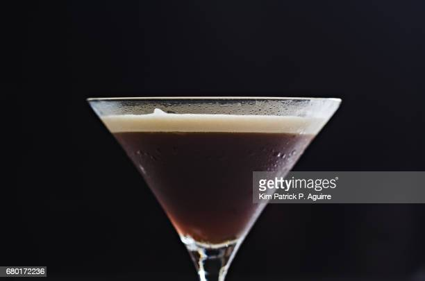 coffee martini on a black background - espresso stock photos and pictures