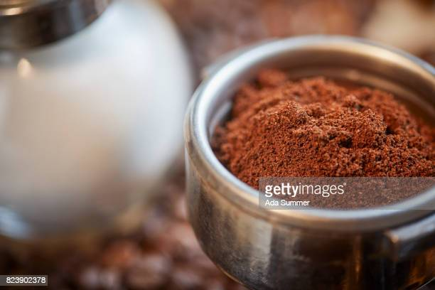 Coffee meal in a coffee maker mount on a table with coffee beans and sugar