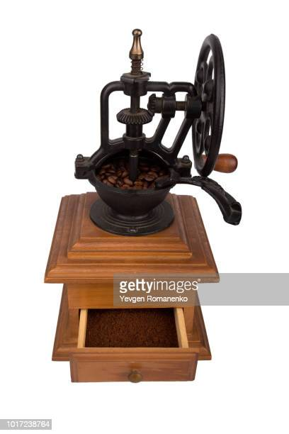 coffee mill, isolated on white coffee grinding machine - coffee grinder stock photos and pictures