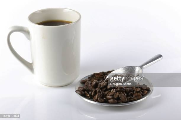 Coffee Mug and beans on a white background