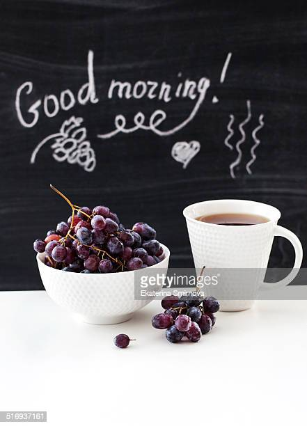 Coffee Mug And Fresh Grape On The Table