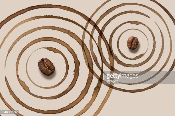 coffee mug stain ripples crossing over - caffeine stock pictures, royalty-free photos & images