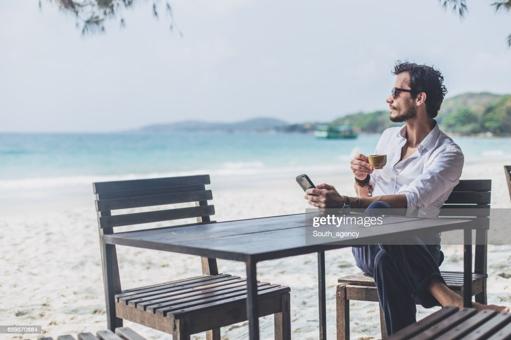 Coffee on the beach alone : Stock Photo