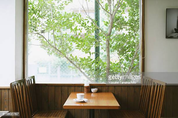 Coffee on wooden table in a cafe