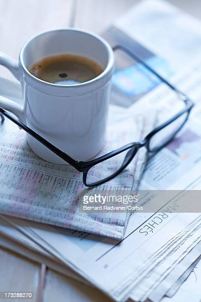 coffee, pair of glasses and newspaper