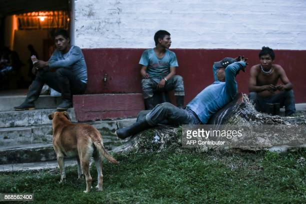 Coffee pickers rest at a plantation's camp at the end of their working day in the mountainous area near Ciudad Bolivar Antioquia department Colombia...