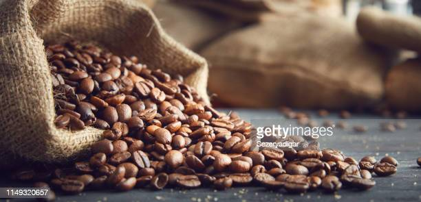 coffee - roasted coffee bean stock photos and pictures