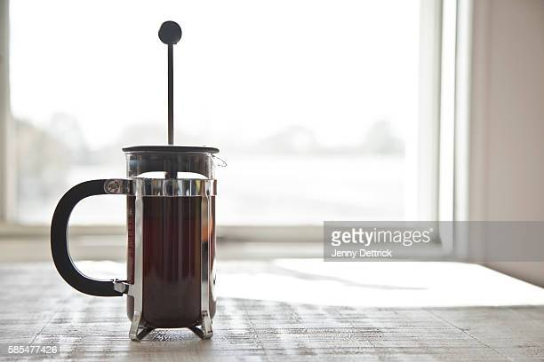 Coffee plunger on table