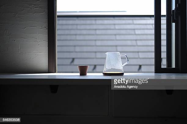 A coffee pot and a cup are seen on a kitchen furniture at the Minimalist Naoki Numahatas home in Tokyo Japan on July 02 2016 Naoki Numahata a...