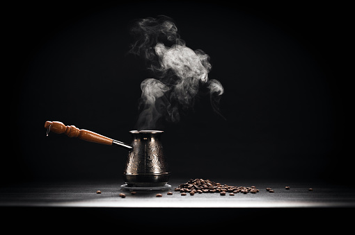 Coffee pot and roasted coffee beans on black background - gettyimageskorea