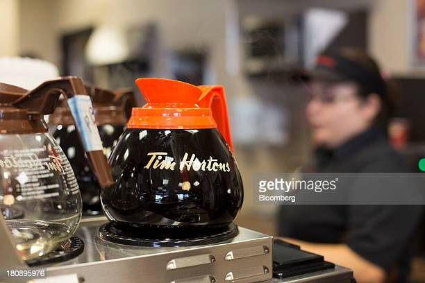 A coffee pot sits on a burner at a Tim Hortons Inc restaurant in Oakville Ontario Canada on Monday Sept 16 2013 Tim Hortons Inc Chief Executive...