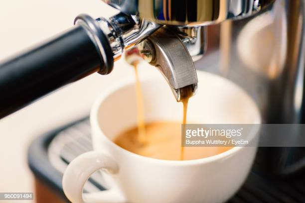 Coffee Pouring From Machine In Cup