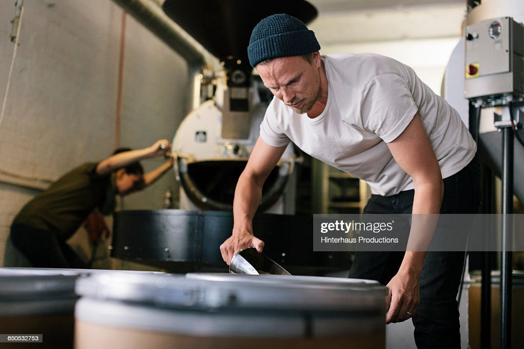 Coffee Roaster and Apprentice working : Stock Photo
