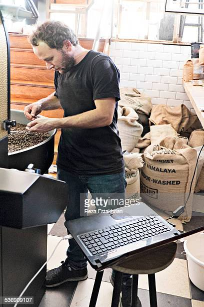 Coffee roaster checks quality of product