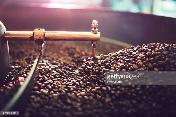 coffee roaster cooling batch of beans - coffee stock photos and pictures