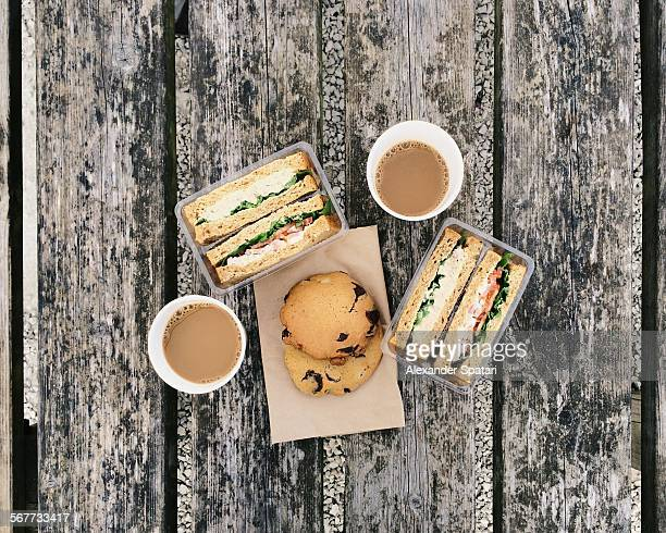 Coffee, sandwiches and cookies on the old table