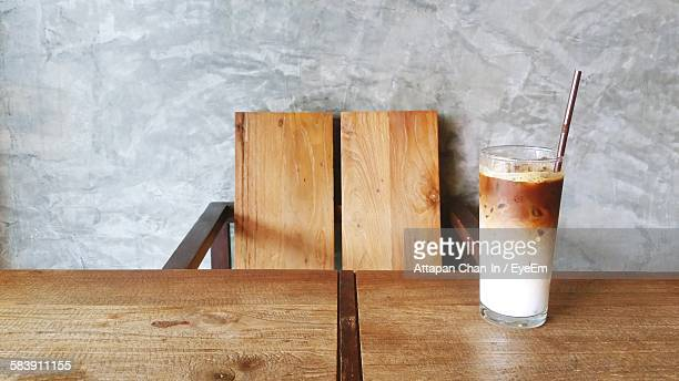 Coffee Served In Drinking Glass On Wooden Table