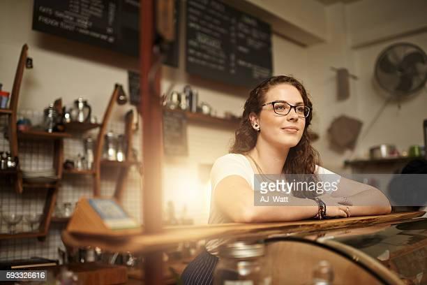 coffee shop contemplation - happy merchant stock pictures, royalty-free photos & images