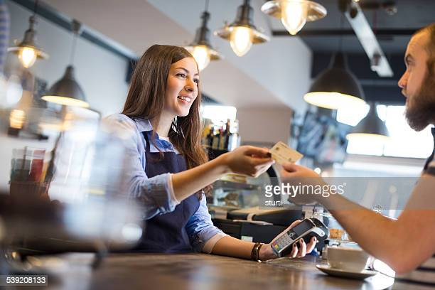 coffee shop credit card payment - credit card reader stock pictures, royalty-free photos & images