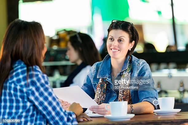 coffee shop owner interviewing new employee for barista job - casual clothing stock pictures, royalty-free photos & images