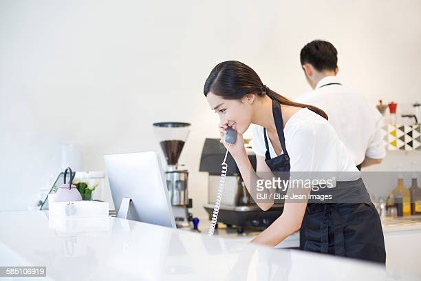 Coffee shop owner talking on the phone