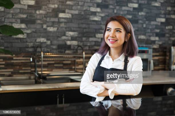 coffee shop owner working at cafe - ibnjaafar stock photos and pictures