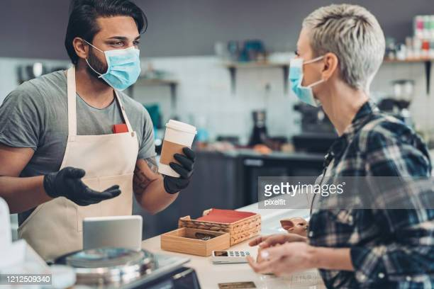 coffee shop owner working with a face mask and protective gloves - service stock pictures, royalty-free photos & images