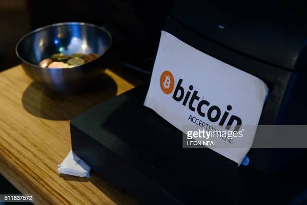 A coffee shop sign advertises that the digital currency 'Bitcoin' is accepted in central Dublin on February 23 2016 / AFP PHOTO / LEON NEAL