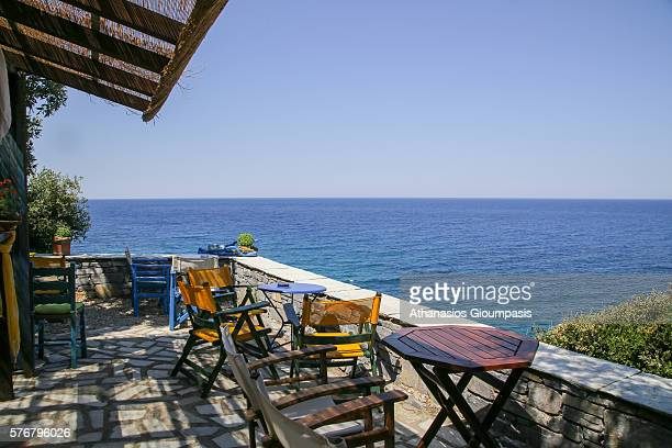 Coffee shop with view to Aegean sea at Milopotamos beach on July 10 2016 in PelionGreece On the Aegean side of East Pelion is the Milopotamos beach...
