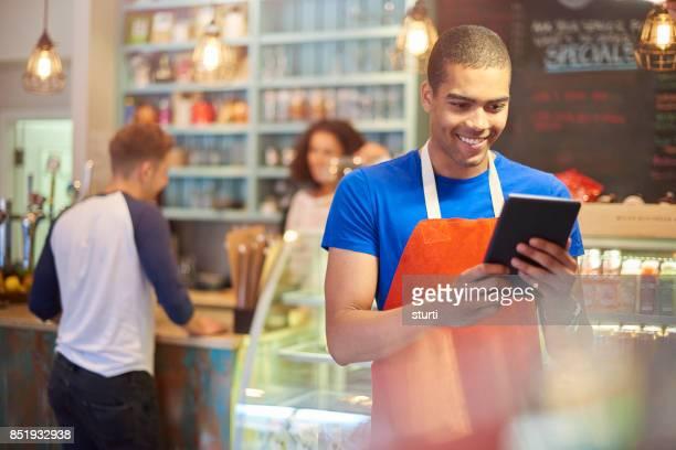 coffee shop worker posting social media