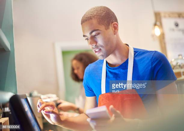 coffee shop worker with digital order screen - cash register stock pictures, royalty-free photos & images