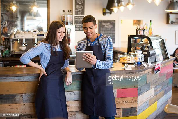 coffee shop workers using a digital tablet