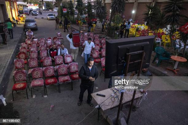 Coffee shops prepare screens and seating ahead of the CAF Champions League final football match between AlAhly vs Wydad Casablanca in Cairo's 6th of...