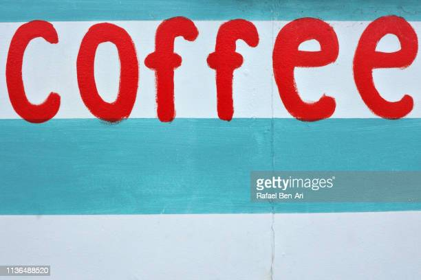 coffee sign on a wooden background - rafael ben ari fotografías e imágenes de stock
