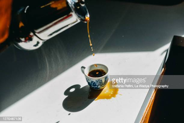 coffee spilled outside the espresso cup as a mistake - failure stock pictures, royalty-free photos & images