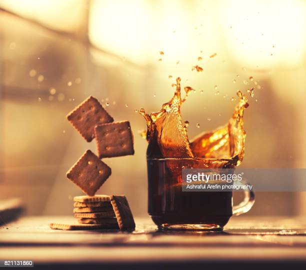 Coffee splash in cap and falling cookies