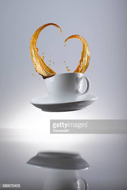 Coffee splashing in cup