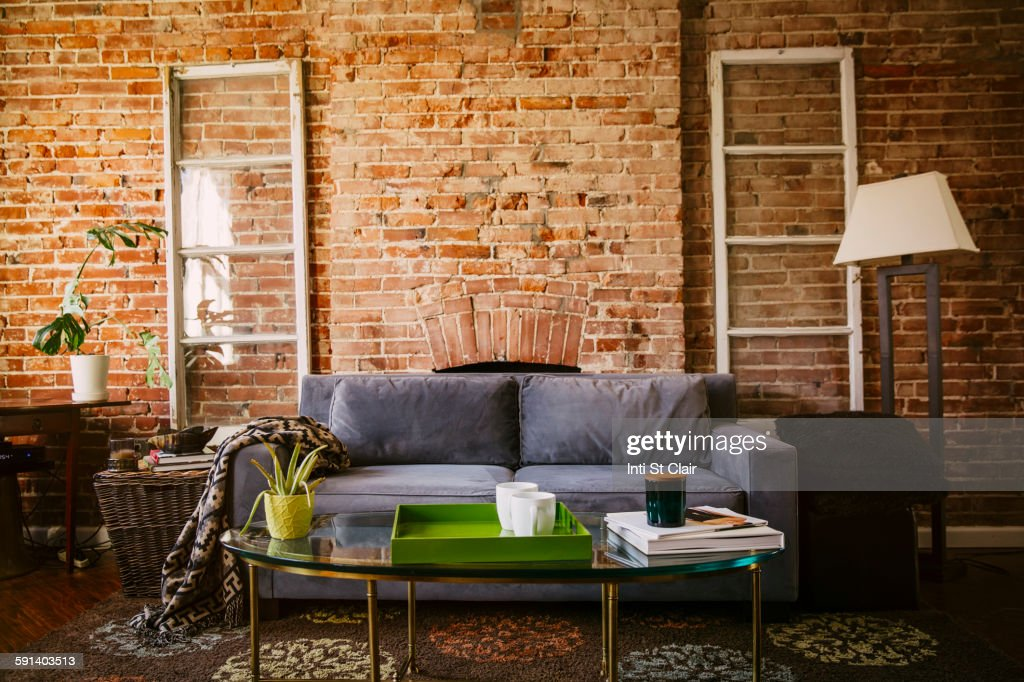 Coffee table and sofa in modern living room : Stock Photo