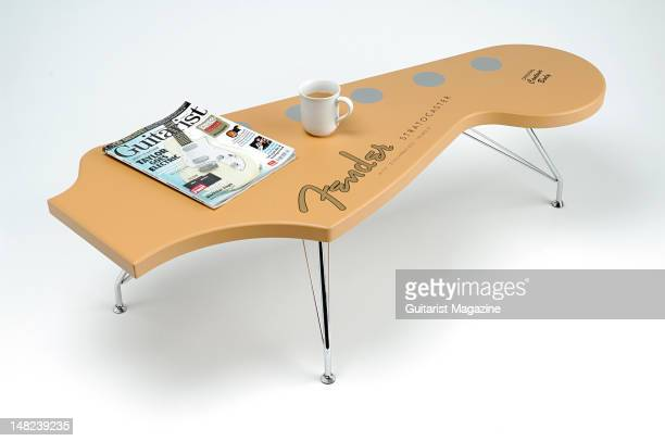 A coffee table in the shape of a Fender Stratocaster electric guitar headstock during a studio shoot for Guitarist Magazine February 7 2008