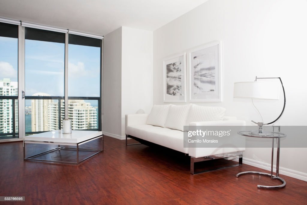 Coffee table, sofa and windows in modern living room : Foto stock