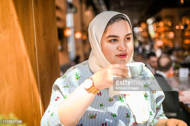 coffee time. - arab women fat stock pictures, royalty-free photos & images