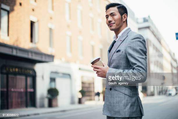 coffee to go - handsome chinese men stock pictures, royalty-free photos & images