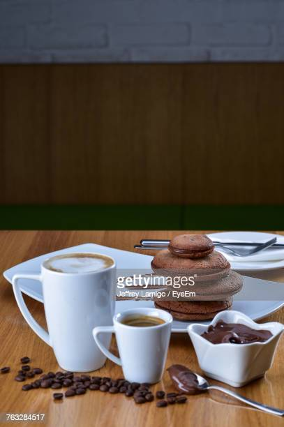 Coffee With Cookies On Table