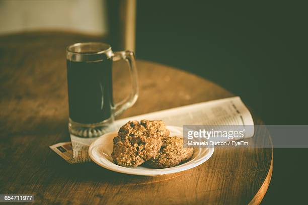 coffee with cookies served on table - empty paper plate stock photos and pictures